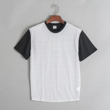 100% poly White front. Back and sleeves Black